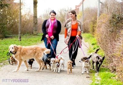 women walking dogs