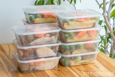 Home-cooked food packed in lunch boxes