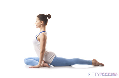 woman doing pigeon pose for weight loss