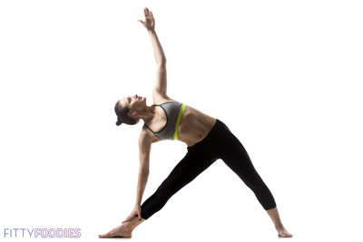 Woman doing triangle yoga asana for weight loss