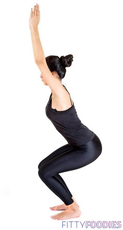 Woman doing chair yoga asana for weight loss