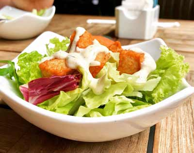 salad with dressing and toppings