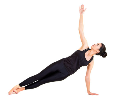 Woman doing side plank yoga asana for weight loss