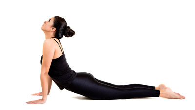 Woman doing upward facing dog yoga pose