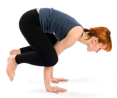 Woman doing crow pose